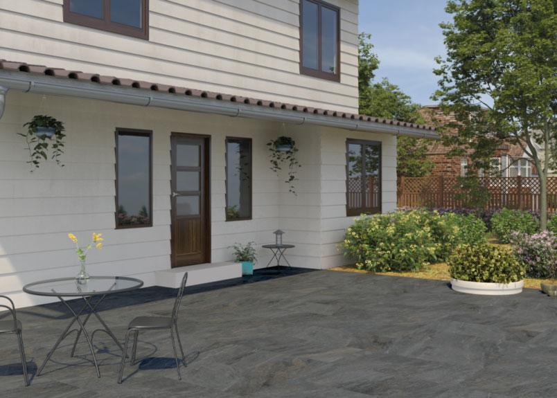Terrasse mit Sträuchern und Keramik Terrassenplatten Schieferoptik pureto Schiefer multicolor