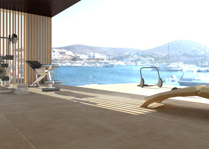 moderen Terrasse mit verglaster Balkonbrüstung und Blick auf eine Hafenstadt KeramikTerrassenplatten in beiger Betonoptik pureto Town beige