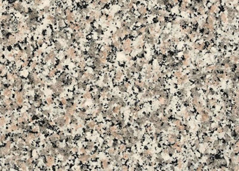 Detailaufnahme Natursteinplatte Granit Rosa Beta mit körniger Optik in Schwarz, Weiß, Grau und zartem Rosa
